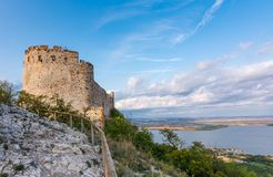 Castle in Palava, Czech republic, ruins of wall, landscape panorama of near village.  royalty free stock photography