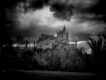 The castle. Panoramic view of the Alcazar of Segovia Castle over the mountain royalty free stock photos