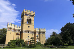 Castle in the park. A beautiful yellow castle inside an urban park Royalty Free Stock Images