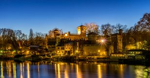 Castle at the park of valentino in turin. Panorama of Turin at Blue hour stock photography