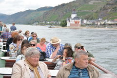 Castle Pfalzgrafenstein in river Rhine. Kaub, Germany - September 16, 2016 - Senior tourists look at beautiful castle Pfalzgrafenstein near Kaub from boat stock images
