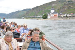 Castle Pfalzgrafenstein in river Rhine. Kaub, Germany - September 16, 2016 - Senior tourists look at beautiful castle Pfalzgrafenstein near Kaub from boat royalty free stock photo