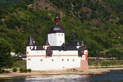 Castle pfalzgrafenstein. The castle pfalzgrafenstein stands on the well-known under the name of sokolov rock island in the rhine, 110 meters and 160 meters from stock photo