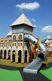 Castle playground. Details of castle playground on cloudy blue sky Stock Image