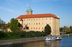 Castle Podebrady with river boat, Czech Republic. Castle Podebrady  with the statue of King George from the Poděbrad, Central Bohemia, Czech republic Royalty Free Stock Images