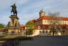 Castle Podebrady with statue, Czech Republic. Castle Podebrady  with the statue of King George from the Poděbrad, Central Bohemia, Czech republic Royalty Free Stock Photos