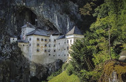 Castle Predjama. One of the most special and specific castles in the world is Predjama Castle in Slovenia. It is built in a rocky wall and hides the cavity Royalty Free Stock Images