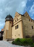 The Castle at Quedlinburg. On top of a sandstone cliffl lies the Abbey of Quedlinburg which is surrounded a.o. by this yellow coloured castle stock images