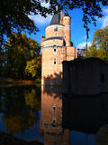 Castle reflected in water Stock Photography