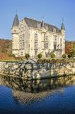 Castle reflecting in moat stock photography