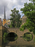 Castle reflecting in river. Old town spire reflecting into river Stock Image