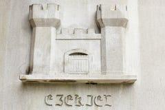 Castle Religious Symbol on White Background. The castle religious symbol with Latin. Located on the e of the Baker Memorial United Methodist Church in Saint stock photography
