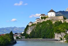 Castle on a rock above river with blues sky in the background stock photos