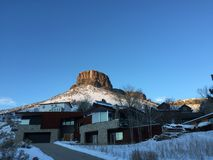 Castle Rock Butte in Golden. The Castle Rock Butte in Golden, Colorado with a modern home in the foreground Stock Photography