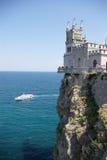 Castle, rock, ship and sea. Authentic castle on rocks over sea and white cruise boat. Crimea, Ukraine Stock Images