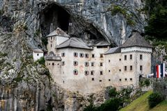 Castle in rock in Slovenia. Predjama Castle, Slovenia`s famous castle stock photos