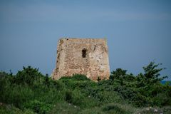 Castle rock tower Adriatic sea Italia blue coast apulia stock image