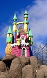 Castle on the Rocks. This is a Winter picture of a fiberglass castle sitting high on top boulders at a putt-putt golf course located in Barrington Hills Royalty Free Stock Image