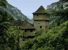 Castle in rocky valley Royalty Free Stock Photos