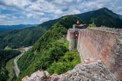 Castle in Romania. Ruined Poenari Castle on Mount Cetatea in Romania stock photo
