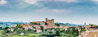 Castle and roofs. Imposing castle and roofs of colored houses brighten the tranquility of a medieval village in the hills of Romagna in Italy royalty free stock photography