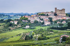 Castle and roofs. Imposing castle and roofs of colored houses brighten the tranquility of a medieval village in the hills of Romagna in Italy stock photos