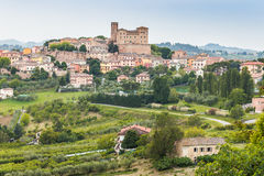 Castle and roofs. Imposing castle and roofs of colored houses brighten the tranquility of a medieval village in the hills of Romagna in Italy royalty free stock photos
