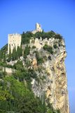 Castle ruin of Arco, Italy. The castle ruin of Arco, on a steep cliff, near Lake Garda, Trentino province, Italy Royalty Free Stock Photo