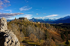 Castle ruin Eisenberg with view to Alps. Landscape of Allgäu, Bavaria Germany, to medieval castle ruin Eisenberg on a sunny day in spring. The vast alpine Stock Images