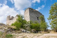 Castle ruin on the hill, blue sky and white clouds, path on the ground Stock Photo