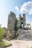 Castle ruin on the hill, blue sky and white clouds, path on the ground Royalty Free Stock Images