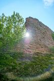 Castle Ruin Wall. Sun shining past wall fragment at the Madenburg castle ruin near Landau in der Pfalz, Germany Royalty Free Stock Photos