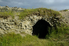 Castle ruins. Entrance to the catacombs of the castle ruins Royalty Free Stock Photography