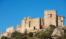 Castle ruins. Old castle ruins in the top of a hill stock images