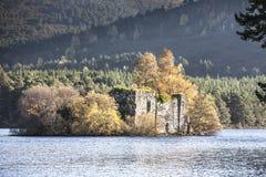 Castle ruins on Loch an Eilein. At Rothiemurchus in Aviemore,Scotland Stock Image
