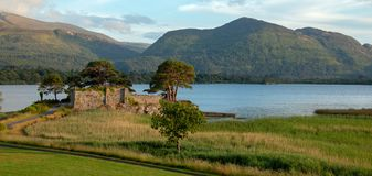 Castle ruins McCarthy Mor on Lake Lough Leane at Killarney on the Ring of Kerry in Ireland. IRE stock photography