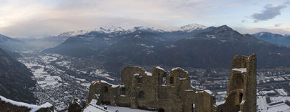 Castle ruins and mountains. Photo of sacra di san michele abbey (Italy) in a beautiful mountain landscape Royalty Free Stock Image