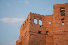 Castle ruins. Ruined castle on the background of sky Royalty Free Stock Photo