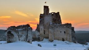 Castle ruins at sunset Stock Images