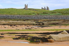 Castle ruins on top of hill by sea royalty free stock photo
