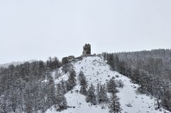 Castle ruins in winter. Scenario on top of mountain in north Italy area Royalty Free Stock Photo