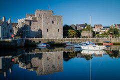 Castle Rushen Castle and Castletown harbor Royalty Free Stock Photos