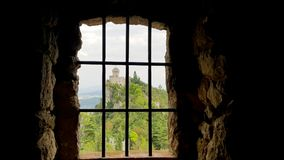 Castle rusted jail view. Ancient terrifying jails in italian castle with views through the bars stock photo