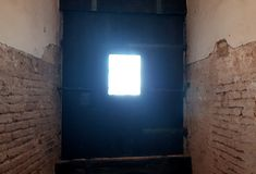 Castle rusted jail view. Ancient terrifying jails in italian castle with views through the bars royalty free stock photo