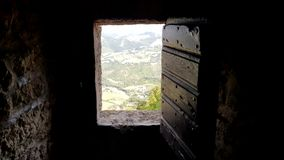 Castle rusted jail view. Ancient terrifying jails in italian castle with views through the bars stock photography