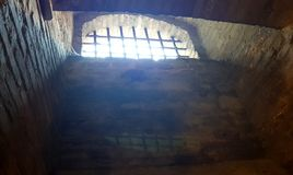 Castle rusted jail view. Ancient terrifying jails in italian castle with views through the bars stock image