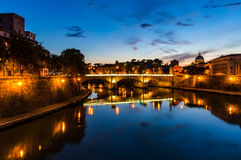 Castle Saint Angel and bridge over Tiber river on sunset Stock Photography
