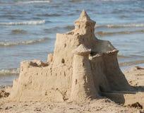 Castle on sand. By the sea coast Stock Photo
