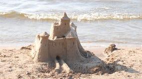 Castle on sand. By the sea coast Stock Photos