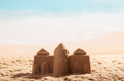 Castle in the sand close up on background of sea. Castle in the sand close up on a background of the sea royalty free stock photography